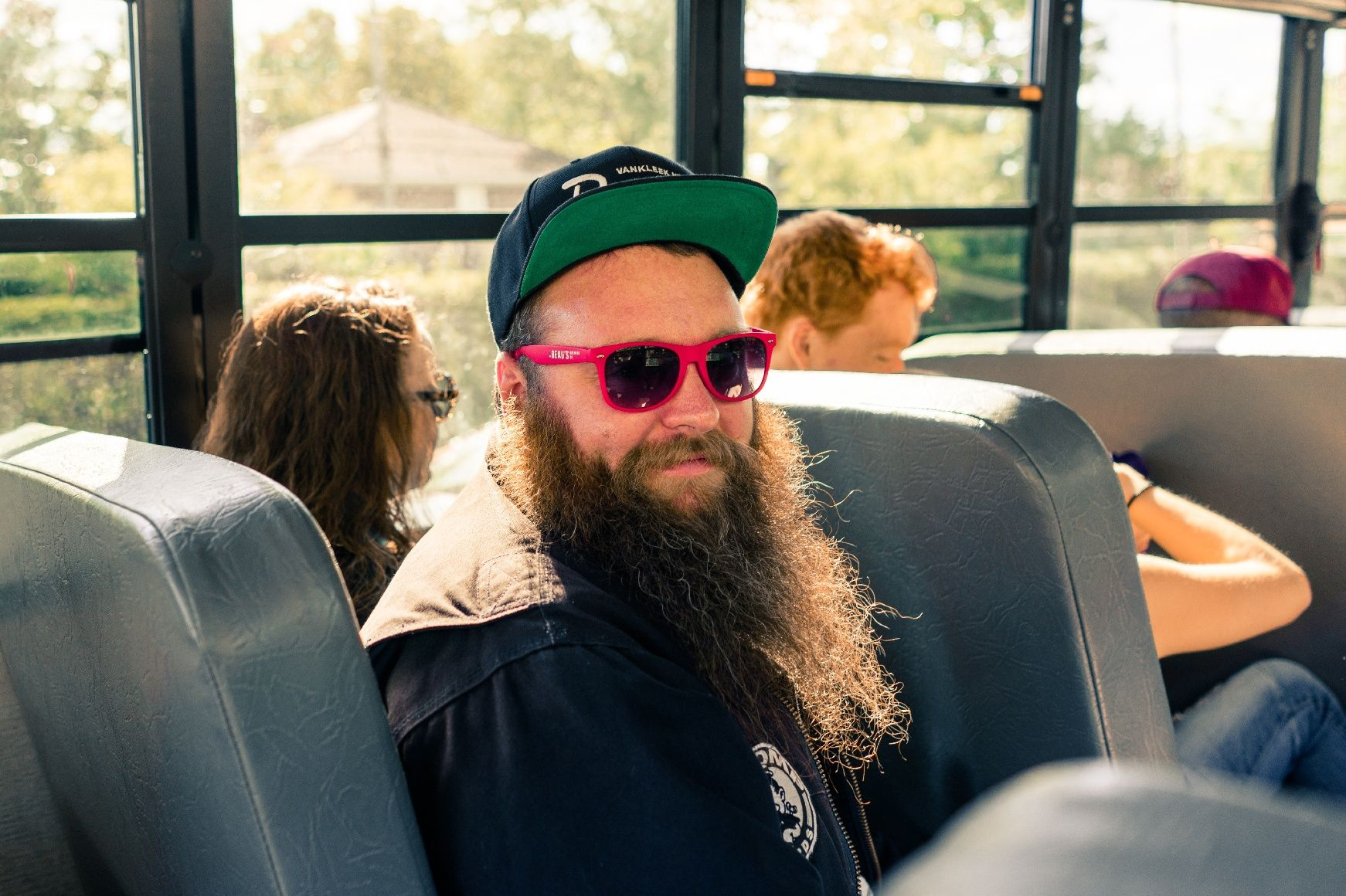Brewery fan riding bus to beer festival