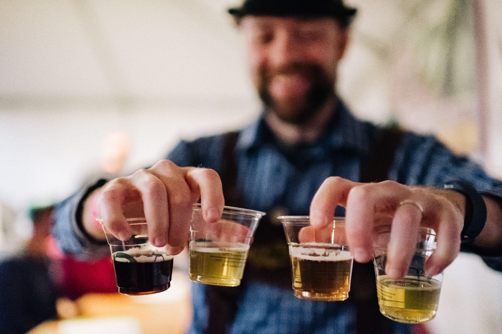 Bartender at Beau's Oktoberfest serving beer