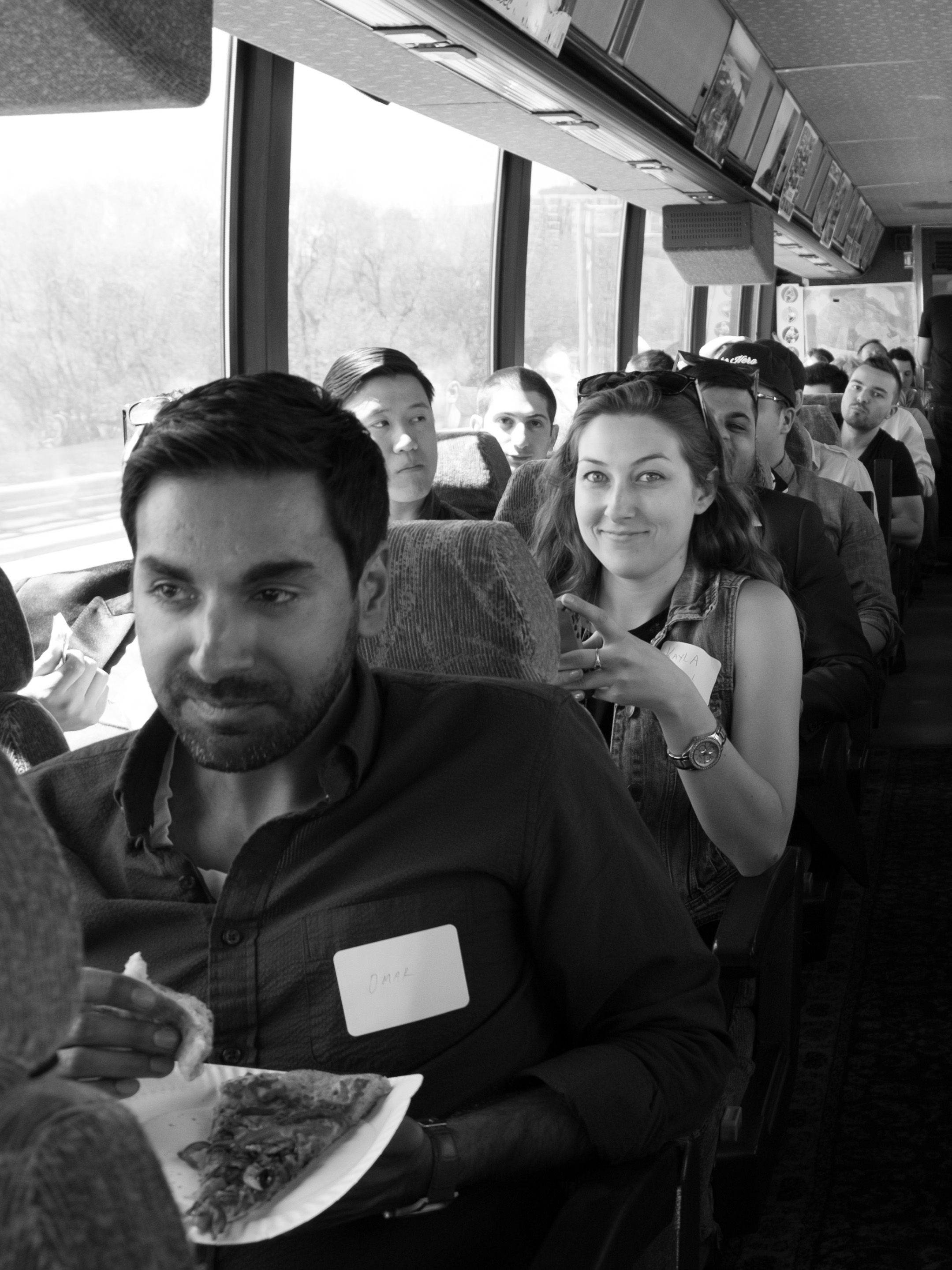 People enjoying pizza on a bus during Founder Fuel's Demo Day
