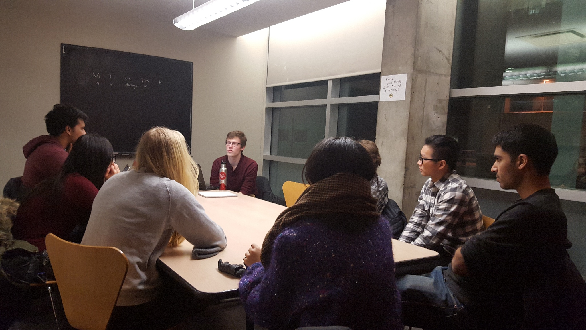 Students in a classroom meeting for a hackathon