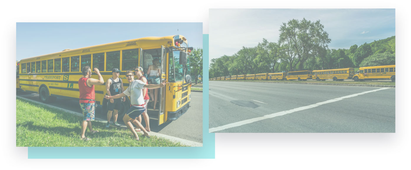 Bus.com employee greeting riders in front of a transport s&l bus with other buses lined up across the street